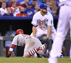 August 7, 2017 - Kansas City, MO, USA - Kansas City Royals third baseman Mike Moustakas looks for the ball on a throwing error by catcher Drew Butera that allowed St. Louis Cardinals' Dexter Fowler to score in the fourth inning at Kauffman Stadium on Aug. 7, 2017 in Kansas City, Mo. (Credit Image: © John Sleezer/TNS via ZUMA Wire)
