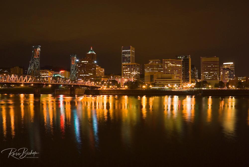 Portland skyline at night reflected in the Willamette River, Portland, Oregon
