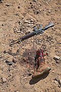 A severed leg and an abandoned gun, tell-tell signs of a staged meltdown in the fabricated Iraqi village town of Medina Wasl at Camp Irwin, California. The village is used for training soldiers deploying to Iraq.