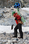 Heather Lynch carrying a Google Street View camera, Cuverville Island, Antarctica.