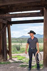 hot cowboy under a railroad trestle
