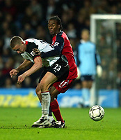 Photo. Aidan Ellis.<br />Fulham v Bolton Wanderers.<br />FA Barclaycard Premiership.<br />6/12/2003.<br />Fulham's Sean Davis and Bolton's Ricardo Gardner