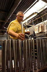 HERSTAL, BELGIUM - APRIL-11-2003 - Technicians work witn state of the art computer controled lathes that cut the highest quality metals into gun barrles at the FN Herstal weapons fabrication plant near Liege, Belgium. (PHOTO © JOCK FISTICK)