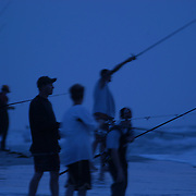 Fisherman cast in hopes for Red Snapper at the tip of Cape Hatteras, NC.