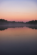 Light fog covers the lake Purezers at dawn, near Puikule, Latvia Ⓒ Davis Ulands   davisulands.com