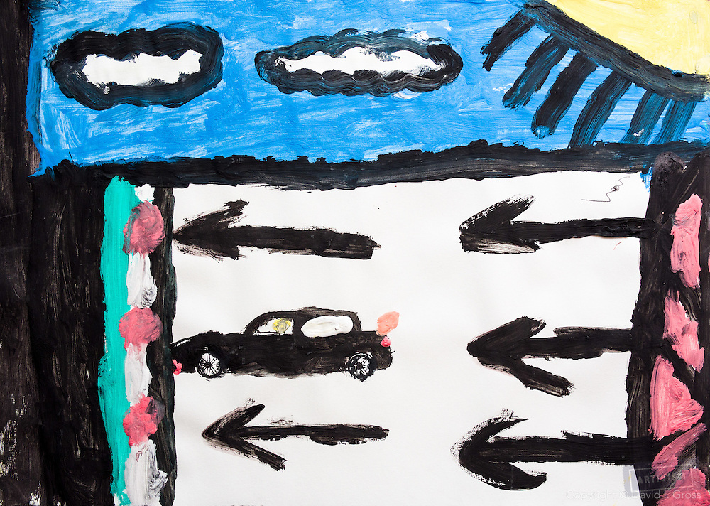 The drawing is about the child's desire to return home to Syria. It shows the family car returning from Turkey (on the right) toward Syria.