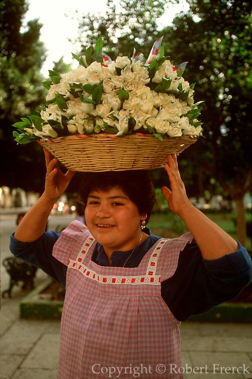 MEXICO, COLONIAL CITIES Oaxaca, Zocalo with a flower vendor