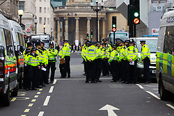 Police assemble before they start making arrests after issuing protesters with a Section 14 notice at an impromptu rave at Oxford Circus as hundreds of environmental protesters from Extinction Rebellion occupy Oxford Circus, a pink yacht being the focal point of their presence, with traffic denied access to two of London's busiest streets. London, April 16 2019.