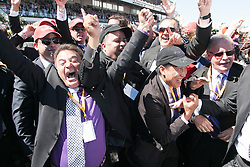 © Licensed to London News Pictures. 5/11/2013. Part owners of Melbourne Cup winning horse Fiorente celebrate during Melbourne Cup Day at Flemington Racecourse on November 5, 2013 in Melbourne, Australia. Photo credit : Asanka Brendon Ratnayake/LNP