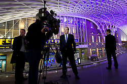 © Licensed to London News Pictures. 02/01/2014. London, UK. Transport minister Stephen Hammond talks to media in Kings Cross Station as commuters across the country deal with a new years rise in rail fares. Photo credit: Matt Cetti-Roberts/LNP