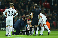 Eric Dier of Tottenham Hotspur receiving medical treatment during the 1st half. UEFA Champions league match, group E, Tottenham Hotspur v CSKA Moscow at Wembley Stadium in London on Wednesday 7th December 2016.<br /> pic by John Patrick Fletcher, Andrew Orchard sports photography.