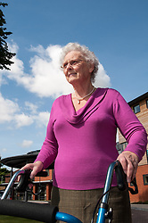 Pensioner in supported housing using a walking aid