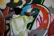 Grafitti artists at work on concrete at the Southbank. This area is set aside for skateboarding, BMX bikes etc and anything hip hop art orientated.