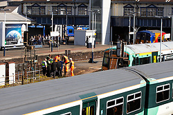 © licensed to London News Pictures. LONDON, UK  04/05/2011. Undertakers recover the body of a person hit by a train at about 7:30am this morning in full view of morning commuters. The incident caused significant disruption at the height of rush hour. Police are treating the death as not suspicious. Please see special instructions for usage rates. Photo credit should read CLIFF HIDE/LNP