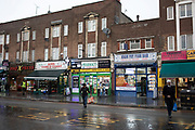 Street scene on a wet day in Leytonstone in East London, United Kingdom. Leytonstone is an area of East London, and part of the London Borough of Waltham Forest.
