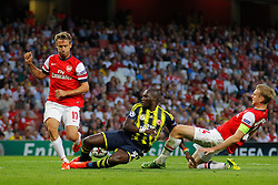 27.08.2013, Emirates Stadion, London, ENG, UEFA CL Qualifikation, FC Arsenal vs Fenerbahce Istanbul, Rueckspiel, im Bild Arsenal's Nacho Monreal Fernerbache's Moussa Sow and Arsenal's Per Mertesacker compete for the ball during the UEFA Champions League Qualifier second leg match between FC Arsenal and Fenerbahce Istanbul at the Emirates Stadium, United Kingdom on 2013/08/27. EXPA Pictures © 2013, PhotoCredit: EXPA/ Mitchell Gunn<br /> <br /> ***** ATTENTION - OUT OF GBR *****