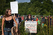 Vanessa Vine from Frack Free Sussex in a field of baby Christmas trees with fellow anti-frack activists. Anti-fracking activists join hands to surround the Cuadrilla fracking site. Thousands turned out for a march of solidarity against fracking in Balcombe. The village Balcombe in Sussex is the  centre of fracking by the company Cuadrilla. The march saw anti-fracking movements from the Lancashire and the North, Wales and other communities around the UK under threat of gas and oil exploration by fracking.