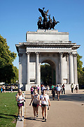 Tourists near to Constitution Arch (Wellington Arch), a memorial to the Duke of Wellington and originally providing a grand entrance to London. People out enjoying the unseasonally hot weather as a summertime heat wave hits London and the UK in what should be Autumn. Summer prolonged in a heatwave which results in a packed Hyde Park as families and friends try to soak up the last rays of sunshine and warmth in this Indian Summer.