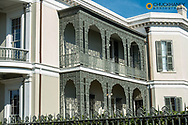 Wrought iron balcony in the Garden District in New Orleans, Louisiana, USA