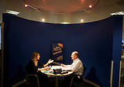 A creative biscuit-making team exchange ideas in a private conference pod at the United Biscuits Group offices, Hayes London