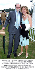 VISCOUNT & VISCOUNTESS COWDRAY at a polo match in West Sussex on 18th July 2004.PXG 85