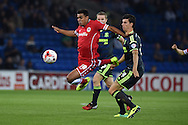 Tom Adeyemi of Cardiff city is fouled by Daniel Ayala of Boro ®. Skybet football league championship match, Cardiff city v Middlesbrough at the Cardiff city stadium in Cardiff, South Wales on Tuesday 16th Sept 2014<br /> pic by Andrew Orchard, Andrew Orchard sports photography.