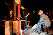 Met een balg wordt het het vuur in de oven aangewakkerd om het brons op de juiste temperatuur te brengen. Op de Domplein in Utrecht wordt een klok gegoten dat door de Utrechtse Klokkenluidersgilde wordt geschonken aan het  Academiegebouw van de Universiteit Utrecht ter gelegenheid van hun 375 jarig bestaan in 2011. Het is voor het eerst sinds eeuwen dat weer een klok in het openbaar wordt gegoten. De klok gaat Anna Maria (genoemd naar de eerste vrouwelijke student aan de universiteit, Anna Maria van Schurman) heten en is gemaakt van brons.<br /> <br /> The oven is being heated up for the right temperature. For the first time in centuries a bell is being casted publicly at the Domplein in Utrecht. The 100 kg bronze bell is a present of the Utrecht Bell-ringing Guild to the University Utrecht which is celibrating its 375 year's anniversary in 2011. The bell is named Anna Maria after the first female student of the university.