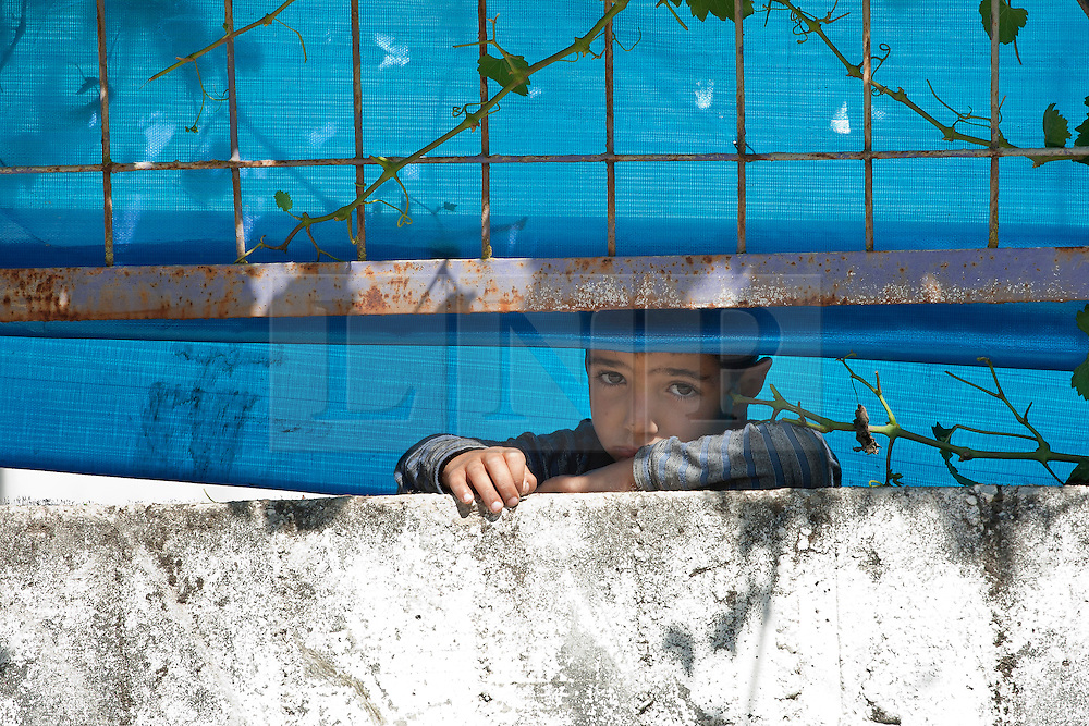 © licensed to London News Pictures. HATAY/ TURKEY. PICTURE DATED. 17/06/2011. A Syrian refugee child at the Turkish Red Crescent camp in the Yayladagi district of the Turkish city of Hatay, two kilometers from the Syrian border, on June 17, 2011. More than 9.000 Syrians have now fled the violence of Syria's 3-month anti-regime uprising against the rule of President Bashar al-Assad and crossed into Turkey in the past ten days. Please see special instructions for usage rates. Photo credit should read TOLGA AKMEN/LNP