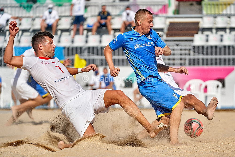 NAZARE, PORTUGAL - SEPTEMBER 4: Oleg Zborovskyi of Ukraine and Sandro Spaccarotella of Switzerland during day 3 of the Euro Beach Soccer League Superfinal at Estadio do Viveiro on September 4, 2020 in Nazare, Portugal. (Photo by Jose Manuel Alvarez/BSWW)