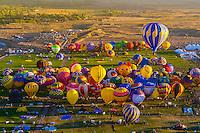 Aerial view, Hot air balloons lifting off from Balloon Fiesta Park, Albuquerque International Balloon Fiesta, Albuquerque, New Mexico USA.