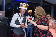 Teacher Dawn Foley, the prom sponsor, crowns the Prom King, Lance Padgett, as Fairdale High School holds it's prom at the Muhammad Ali Center on Saturday, May 18.