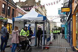 © Licensed to London News Pictures. 12/10/2018. WINDSOR, UK.  Crowds go through security checks in Windsor for the royal wedding of Princess Eugenie and Jack Brooksbank.  Princess Eugenie, 28, the younger daughter of the queen's third child Prince Andrew and his ex-wife Sarah Ferguson, the Duchess of York, will marry Jack Brooksbank, a 32-year-old drinks executive, in Windsor Castle before taking part in a short carriage procession through Windsor town.  This is the second royal wedding in Windsor in 2018, Prince Harry married Meghan Markle in May.  Photo credit: Stephen Chung/LNP