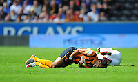 Hull City's Ahmed Elmohamady lays on the ground in pain after being caught in a delicate area by Manchester United's Angel Di Maria<br /> <br /> Photographer Chris Vaughan/CameraSport<br /> <br /> Football - Barclays Premiership - Hull City v Manchester United - Sunday 24th May 2015 - Kingston Communications Stadium - Hull<br /> <br /> © CameraSport - 43 Linden Ave. Countesthorpe. Leicester. England. LE8 5PG - Tel: +44 (0) 116 277 4147 - admin@camerasport.com - www.camerasport.com