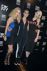 Left to right, RITA ORA, CARA DELEVINGNE and IGGY AZALEA at Club DNKY in celebration of #DKNYARTWORKS held at The Firestation, Lambeth High Street, London SE1 on 12th June 2013.