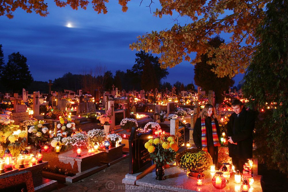 Zadzim Cemetery, Poland. All Saints Day. Olga and her cousin visit relatives graves.