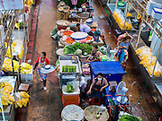 01 APRIL 2014 - BANGKOK, THAILAND: Vendors in the Bangkok flower market. The Yodpiman Flower Market (also called Pak Khlong Talat) is being renovated and gentrified. The market opened in 1961 and has been a Bangkok landmark for more than 50 years, is being turned into a high end mall. Many of the flower and vegetable vendors in the market may be forced out.    PHOTO BY JACK KURTZ