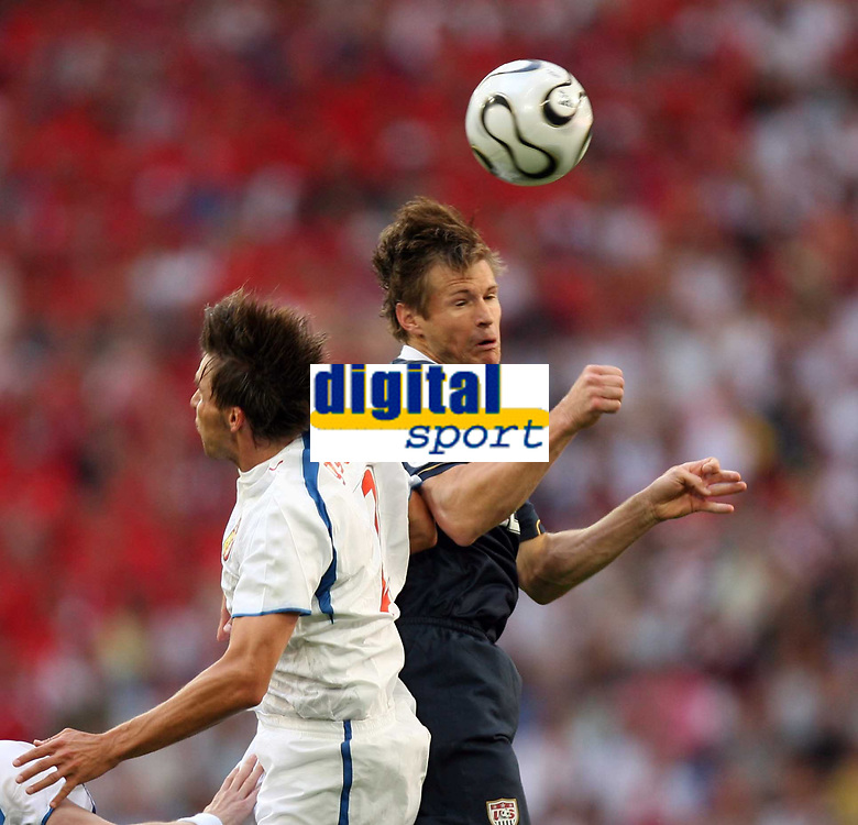 Photo: Chris Ratcliffe.<br /> USA v Czech Republic. Group E, FIFA World Cup 2006. 12/06/2006.<br /> Zdenek Grygera of Czech Republic clashes with Brian McBride of the USA.