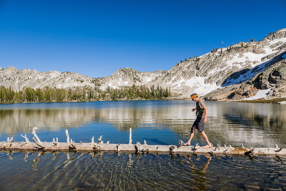 Pierre shows off walking a floating log in Twin Lakes in the Sawtooth Mountains in Idaho.  Licensing and Open Edition Prints.