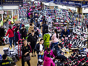 "22 DECEMBER 2017 - HANOI, VIETNAM: Shoes for sale in the wholesale clothes and fabric section of Dong Xuan Market in the old quarter of Hanoi. The old quarter is the heart of Hanoi, with narrow streets and lots of small shops but it's being ""gentrified"" because of tourism and some of the shops are being turned into hotels and cafes for tourists and wealthy Vietnamese.    PHOTO BY JACK KURTZ"