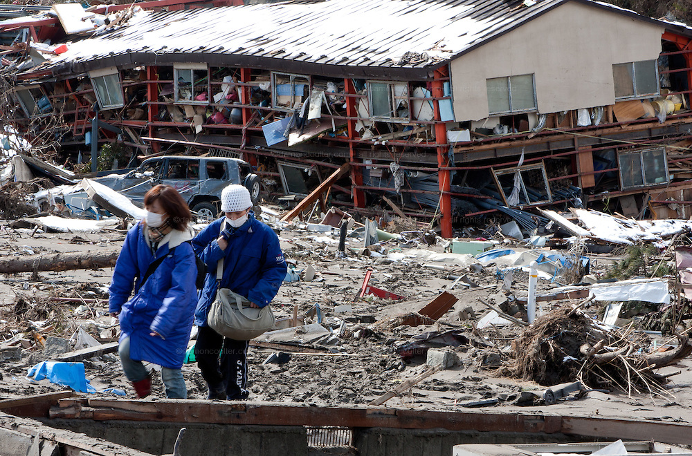 Survivors search for personal possessions through the effects of the tsunami that struck the north east coast of Japan on March 11th in Otsuchi, Iwate, Japan. March 17th 2011