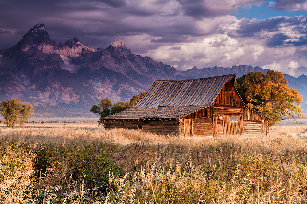 The sky darkens at Moulton Barn as a storm grows over the Tetons