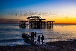 © Licensed to London News Pictures. 02/11/2017. Brighton, UK. Thousands of Starlings perform a acrobatic show above the remains of the Brighton West Pier at sunset, today 2nd November 2017. Photo credit: Hugo Michiels/LNP