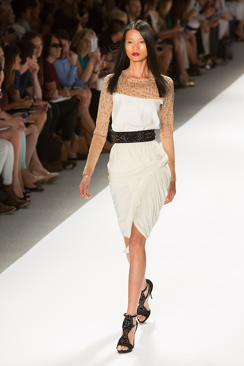 White dress with asymmetrical hem and asymmetrical top, with rhinestones. By Carlos Miele at the Spring 2013 Mercedes-Benz Fashion Week in New York.