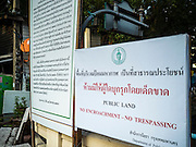 25 SEPTEMBER 2016 - BANGKOK, THAILAND: A sign in English and Thai warning that the land in Pom Mahakan Fort is public land and trespassing is not allowed. City officials are trying to prevent squatters from moving into empty homes in the old fort. Forty-four families still live in the Pom Mahakan Fort community. The city of Bangkok has given them provisional permission to stay, but city officials say the permission could be rescinded and the city go ahead with the evictions. The residents of the historic fort have barricaded most of the gates into the fort and are joined every day by community activists from around Bangkok who support their efforts to stay.      PHOTO BY JACK KURTZ