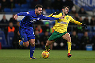 Sean Morrison of Cardiff city tackles Nelson Oliveira of Norwich city (r). EFL Skybet championship match, Cardiff city v Norwich city at the Cardiff city stadium in Cardiff, South Wales on Friday 1st December 2017.<br /> pic by Andrew Orchard, Andrew Orchard sports photography.