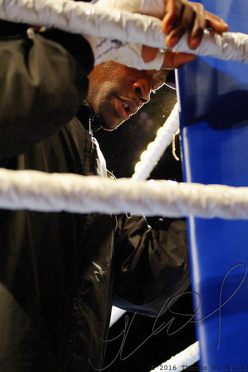 """June 19, 2009 - Richmond, BC - Rumble at the Rock IV - Abdallah Ramadan prays in his corner prior to the start of his fight with Junior Moar..Heavyweight fighters Junior Moar of Richmond, BC, and Abdallah Ramadan of Toronto, Ontario, squared off in a ten round bout for the Canadian Light Heavyweight Title. Ramadan's record going into the fight was 15-8-0 with nine wins by KO. Junior """"The Real Deal"""" Moar's record was 6-2-0 with two wins by KO. .Moar won the Canadian light heavyweight title Friday night when Ramadan was disqualified in the sixth round after seemingly never ending series of low blows..The River Rock Casino Resort hosted the West Coast Promotions Rumble at the Rock VI boxing event at the River Rock Show Theatre."""