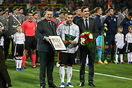 Lukas Podolski of Germany receives a prize and is congratulated before the International Friendly match between Germany and England at Signal Iduna Park, Dortmund, Germany on 22 March 2017. Photo by Phil Duncan.