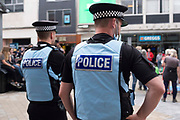 British Police Liaison Officers in uniform at a small public event on 8th August, 2021 in Leeds, United Kingdom. Police Liaison Officers are commonly seen at protests and pre planned events where they are tasked with providing an effective policing response and, sometimes, mutual aid.