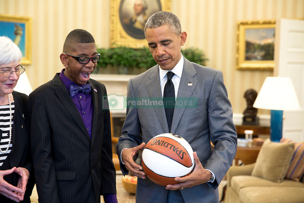 President Barack Obama presents a basketball to the 2015 March of Dimes National Ambassador Elijah Jackson in the Oval Office, April 29, 2015. Dr. Jennifer Howse, President, March of Dimes Foundation stands at left. (Official White House Photo by Pete Souza)<br /> <br /> This official White House photograph is being made available only for publication by news organizations and/or for personal use printing by the subject(s) of the photograph. The photograph may not be manipulated in any way and may not be used in commercial or political materials, advertisements, emails, products, promotions that in any way suggests approval or endorsement of the President, the First Family, or the White House.