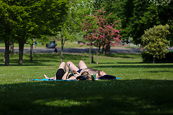 © Licensed to London News Pictures. 09/05/2020. London, UK. Members of the public sunbathe in Finsbury Park, north London on what could be he hottest day of the year so far. Prime Minister Boris Johnson is set to announce on Sunday, 10 May, measures to ease coronavirus lockdown, which was introduced on 23 March to slow the spread of the COVID-19. Photo credit: Dinendra Haria/LNP